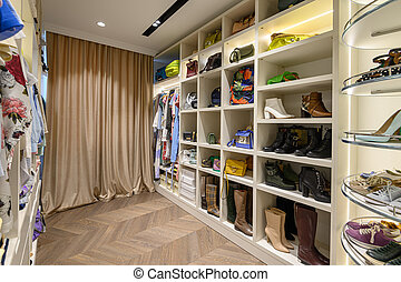 Large woman's wardrobe with different clothes, bags and ...