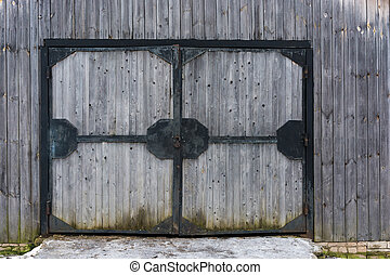 Large wooden gate in an iron frame. - Large wooden gate in a...
