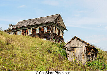 Large wooden house on the hill in the country