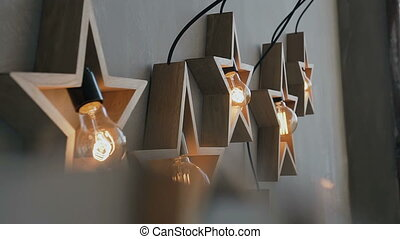 Large wooden stars glow with a lot of lights. Beautiful...