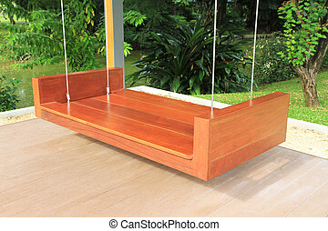 Large wooden swing in the garden