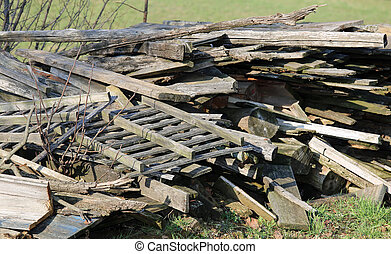 large woodshed with many pieces of wood and other wooden materia