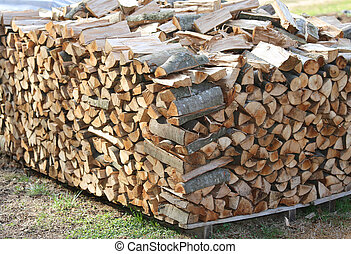 woodshed with many pieces of wood ready to be burned to keep war