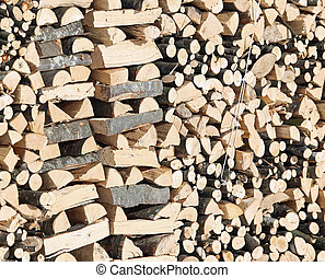 Woodshed with pieces of wood cut for the stove