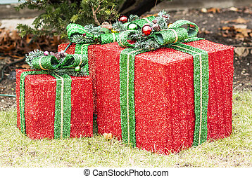 Large wrapped Christmas present ornaments on front lawn