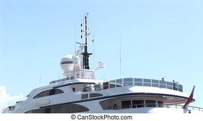 Large yacht docked at port-side