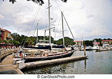 Large Yachts and Sailboats at a Harbor