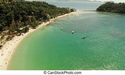 Las Cabanas Beach at El Nido at, Philippines - Aerial drone...