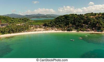 Las Cabanas Beach at El Nido at, Philippines - Aerial drone ...