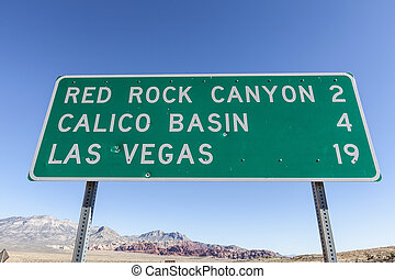 Las Vegas and Red Rock Basin Sign with Bullet Holes