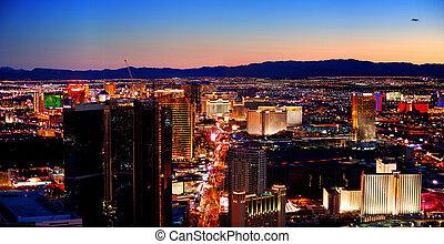 Las Vegas City Skyline panorama with sunset, mountain,...