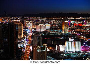 Las Vegas strip skyline night scene with hotel illuminated.