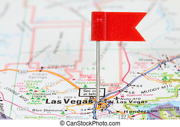 Las Vegas, Nevada. Red flag pin on an old map showing travel...