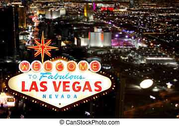 Las Vegas Welcome Sign With Night Time Strip in the...