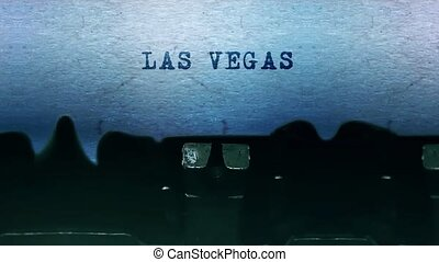 LAS VEGAS words Typing on a sheet of paper with an old vintage typewriter.