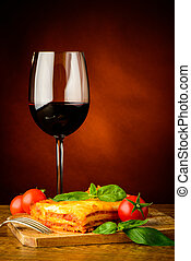 lasagna and glass of red wine