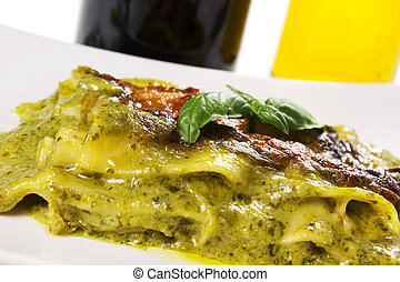 lasagna with pesto with basil on a dish on the table