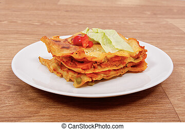 Lasagna with vegetables on a table