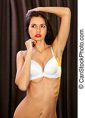 lascivious girl in white bra looks very sexy