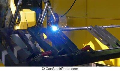 Laser argon welding of metal iron on industrial CNC machine...