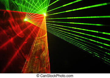 Color laser beams on a black background.