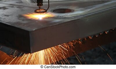 laser cutting metal sheet with sparks