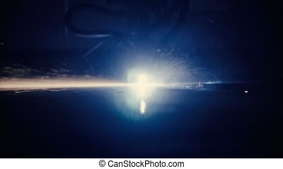 Laser cutting of metal sheet - Close up of laser cutting of...