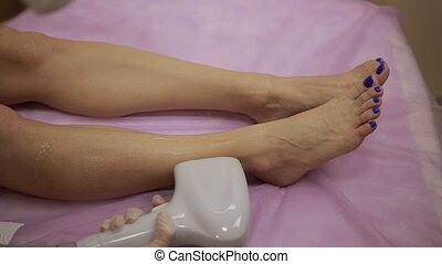 Laser hair removal procedure on female legs - Laser...