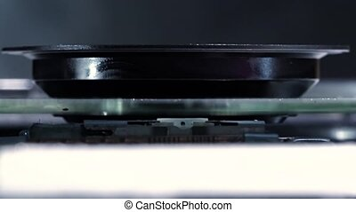 Laser-head red ray of DVD drive, macro shot. - Laser-head of...