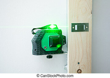 Laser level measuring tool for the installation. - Laser ...