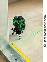 Laser level measuring tool in construction site. - Laser ...