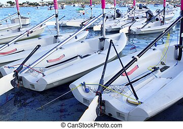 Laser little sailboats row in Formentera
