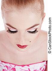 Blonde girl with classical glamorous makeup and false eyelashes