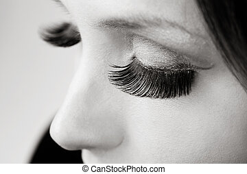 Lashes - Close-up duotone shot of closed eyes with huge...