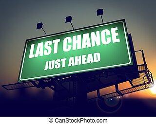 Last Chance Just Ahead on Green Billboard. - Last Chance...