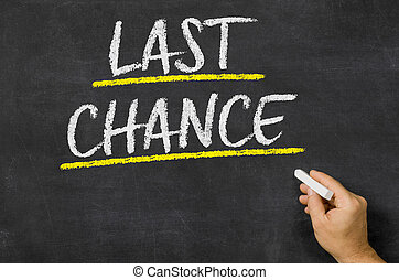 Last chance written on a blackboard