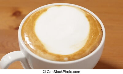 last drops of milk pouring in cappuccino in slow motion, ores footage