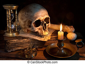 Last hour - Vintage skull on antique book with candle and...