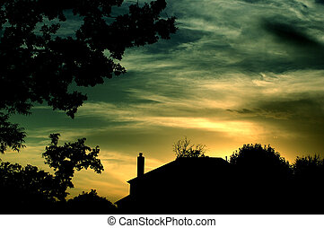 A setting sun illuminates a suburban neighborhood and creates a peaceful and serene mood