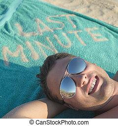 Last Minute beach - Guy enjoying last minute booking on...