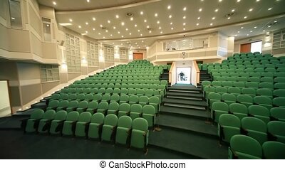 last people comes out from conference hall, panning