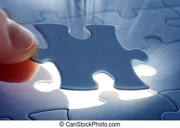 last piece of a Puzzle - Hands placing last piece of a...