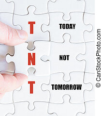Last puzzle piece with Business Acronym TNT - Hand of a...