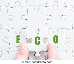 Last puzzle piece with motivational word ECO