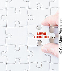Last puzzle piece with words LAW OF ATTRACTION