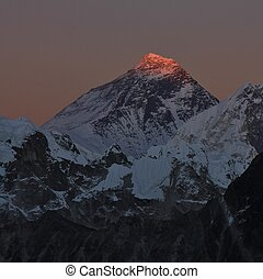 Last sunlight of the day illuminating the peak of Mount Everest. View from Gokyo Ri, Nepal.
