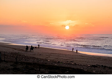 Last sunlight of the day with sunset over the Atlantic Ocean from Agadir beach, Morocco, Africa