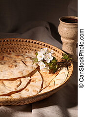 Last supper - Chalice with red wine and pita bread in a ...