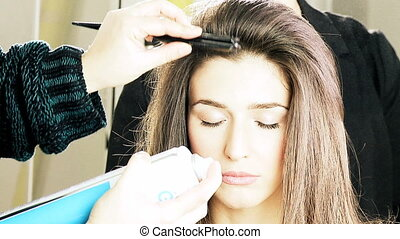 Last touch on hair of female model