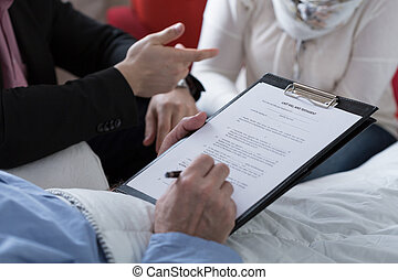 Last will and testament - Close-up of older sick man holding...